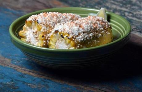 Mexican street corn on the cob with roasted garlic mayo, cotija cheese, and cayenne, as prepared at The Painted Burro in Davis Square. JOSH REYNOLDS FOR THE BOSTON GLOBE (Living/Arts, Lifestyle, first)